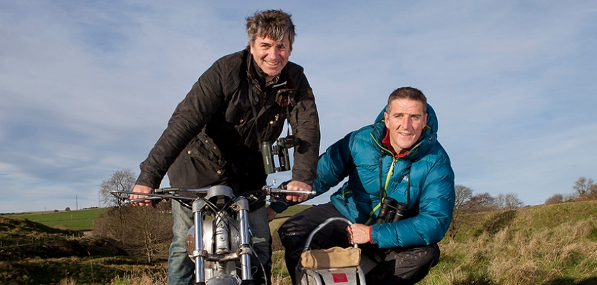 Iolo Williams and Martin Hughes-Games outside with a motorbike