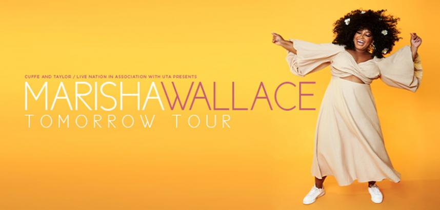 A promotional image of Marisha, mid-dance, against a yellow background. Marisha is wearing a long, cream-coloured dress, flowers in her hair, and a smile on her face.