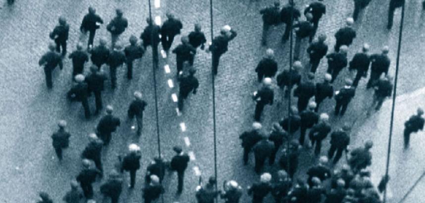 Overhead shot of lots of people walking down a street.