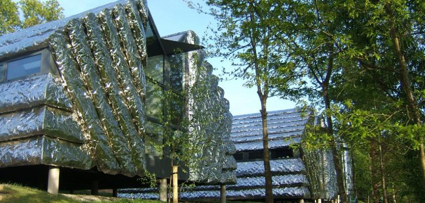 One of the Creative Studios in close-up - a silver, crinkled building (it looks a bit like foil). There are trees around it.