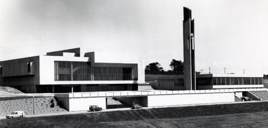 A black and white photo of the Arts Centre, from a distance, date from the 1970s. The Student's Union building is also visible.