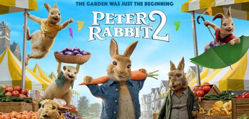 Movie Poster for Peter Rabbit 2. Text above the title reads The Garden was Just the Beginning. Peter Rabbit is shown with a large carrot over his shoulders while other animated characters from the film are in the background