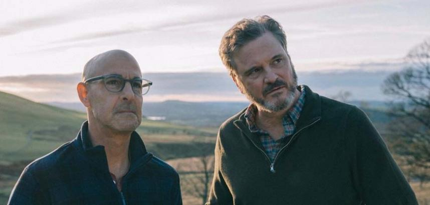 Stanley Tucci and Colin Firth stand together in a still from Supernova