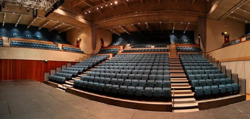 A wide-angle view of the Great Hall auditorium, taken from the stage.