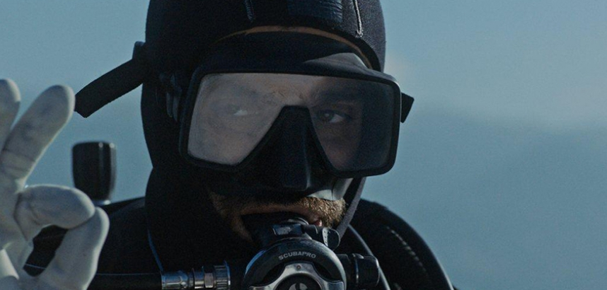 Still from Under the Concrete - close-up of someone in a diving mask