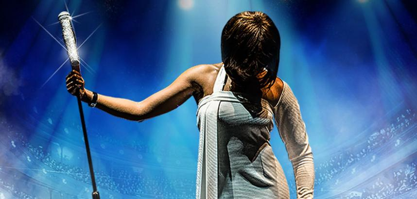 A stylised image of a woman on a stage, holding her mic stand to one side and her head looking down, her face obscured by her bob-cut hair.