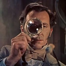 A man holds a mahnifying glass up to his eye