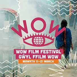 The WOW logo, placed on a film still background, showing a foggy pale blue hued street with the figure of a person walking away from the camera