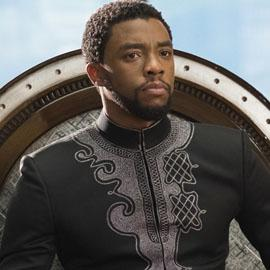 A mid-shot of King T'Challa sitting on his throne.