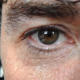 A close up of a mans eye.