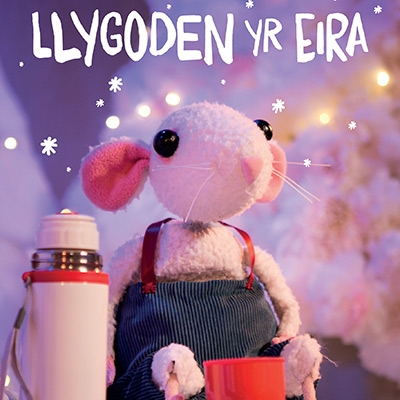 A cute puppet of a white mouse sits in a snowy landscape with a thermos. Text reads Llygoden yr Eira