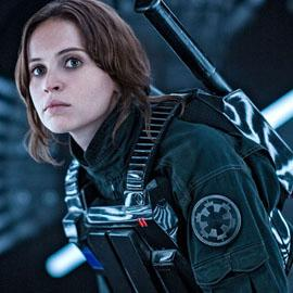Jyn Erso, disguised as a soldier of the Empire, crouches in the Death Star.