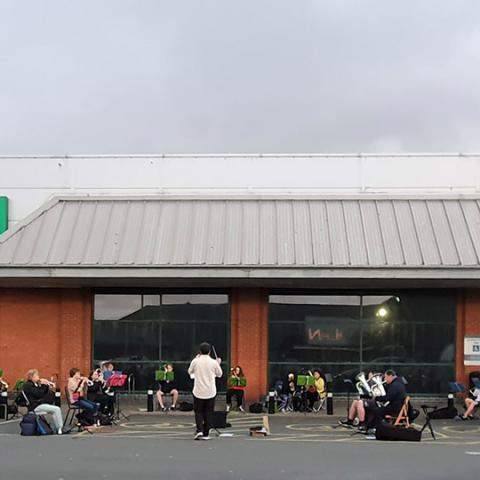 Photograph of the Aberystwyth Silver Band rehearsing outside