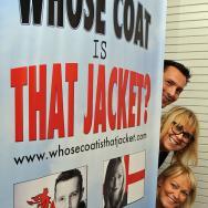 Mack, Jack and Terri behind a banner.