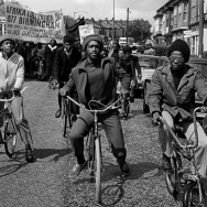Out-riders+head+the Africa Liberation Day rally, Rookery Road, Handsworth 1977.