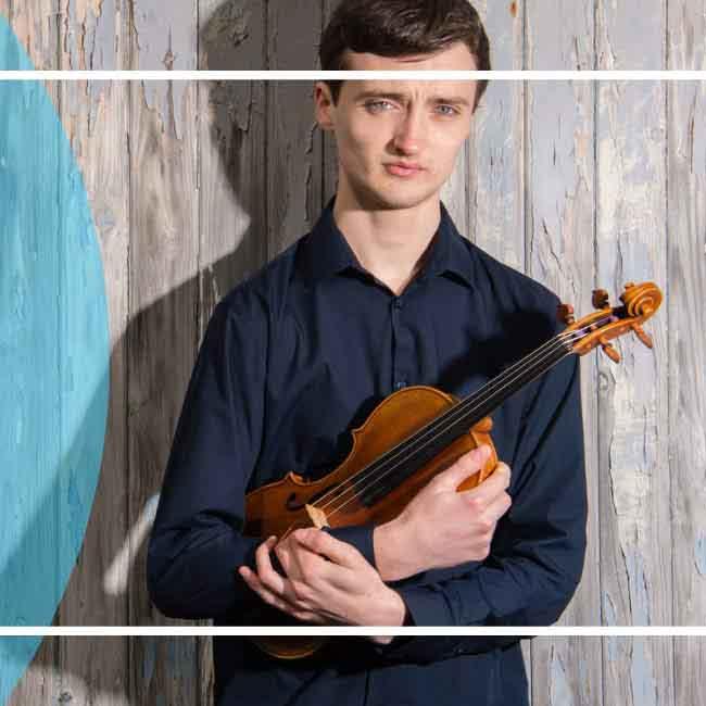 An image of violinist Thomas Mathias with his violin