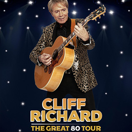Cliff Richard with his guitar