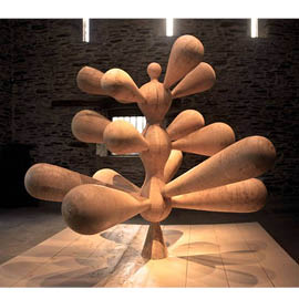 Tree shaped fashioned wood with forms of cones and cylinders