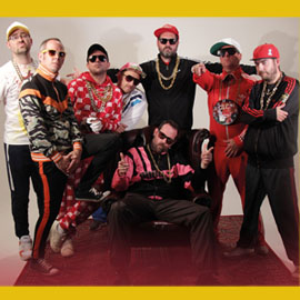A group shot of the band Goldie Lookin' Chain with a yellow background.