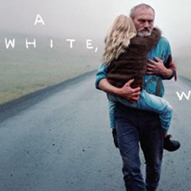 A man carries a blonde child child along a misty stretch of road | Mae dyn yn cario plenty gyda gwallt melyn ar hyd ffordd niwlog.