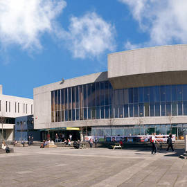 A wide-angle view of the piazza - with the Arts Centre visible in the centre, and other University buildings at the edges.