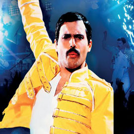 A promotional image of a tribute Freddie Mercury, wearing the iconic yellow jacket.